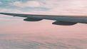 foto vliegtuig wolken luchtverkeersleider